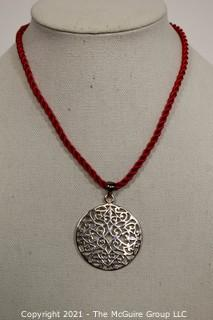 "Pierced Sterling Silver Pendant on Red Cord Necklace.  Measures approximately 2"" in diameter and 11.2 g weight."