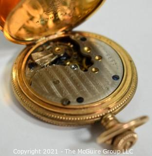 Ladies gold filled 10 year pocket watch case.  Movement, dial and face are incomplete