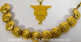 Group of Brass Military Buttons and Pendant.