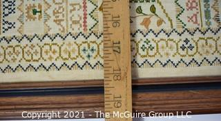 "Framed Vintage Hand Embroidered Sampler.  Measures approximately 26"" x 19""."
