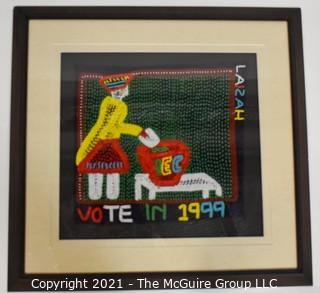 "Framed Hand Beaded Fabric Tapestry Laizah IEC Vote 1999.  It measures approximately 23"" squre."