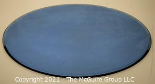 Vintage Oval Shaped Beveled Blue Glass Mirror.  Measures approximately 12 x 16""