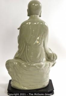 Large Ceramic with Green Glaze Asian Flute Player on Base made by Austin Prod. Inc.   It measures approximately