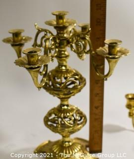 Two Ornation Brass Candlesticks with 4 and 5 Lights.