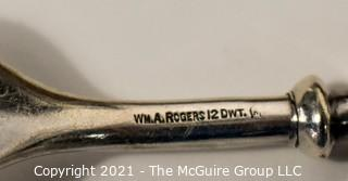 WM Rogers 12 dwt. marked Sterling and Mother of Pearl Handled Flatware Set in Box.