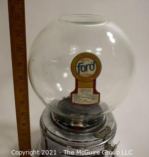 "Ford Table Top Penny Gumball Machine with Original Glass Globe.  Working condition.  It measures approximately 12"" tall."
