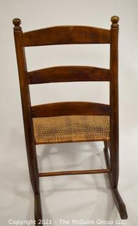 Primitive Hand Made Rocking Chair with Woven Cane Seat.