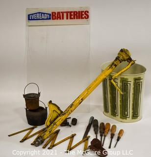 Eclectic Mix.  Includes Yellow Truck Jack, Metal Mid Century MCM Trash Can, EverReady Battery Display Board, Folding Carpenter Rulers, Hand Tools, Etc