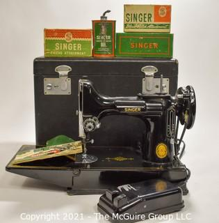 Singer Featherweight Sewing Machine with Accompanying Attachments in Box.