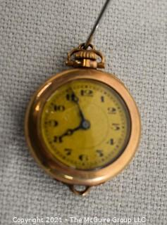 """Vintage Ladies Gold Filled Pendant Watch, Swiss 15 Jewel Movement with Fahys Case.  Measures approximately 1"""" in diameter.  Untested."""