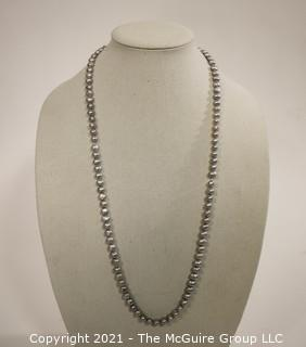 "Opera Length Grey Fresh Water Pearl Necklace wih 14 kt Gold Clasp.  Approximately 32"" long."