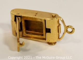 14 kt Gold Articulated Antique Camera Charm or Pendant.  It weighs approximately 5gr.