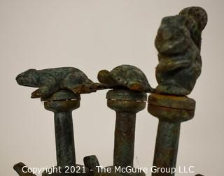 """Vintage Cast Iron Garden Hose Spikes or Guides With Animal Toppers - Frog, Squirrel & Turtle.  Measures approximatley 22"""" tall."""