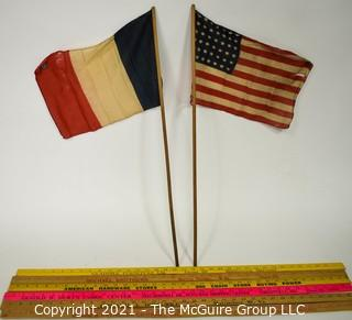 Grouping of six Yard Sticks with Advertising and Vintage French Flag and US Flags (48 stars)