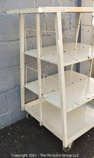 "Trapezoidal 4 Shelf Metal Cart with (2) 4"" locking swivel castors and 2 fixed; top shelf is 14 x 24"" with extending handle; height 40"""