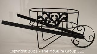 "Metal Wheelbarrow Flower Cart.  Measures approximatley 27""wide x 12"" tall."