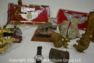 Bill Caldwell Personal Memorabilia: Marine Corp License Plates, Brass items from various trips and Rocks from Base Camp of Mt.Everest