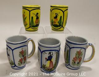 """Set of Five (5) Henriot Quimper French Faience Tulip Shaped Mugs in Soleil Yellow and White with Both a Lady & Gentlemen on the Side.  Each measures approximately 4"""" tall."""