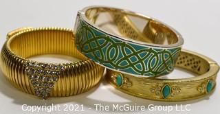 Three (3) Gold Tone Bangle Bracelts with Enamel Decoration.  One signed Stella & Dot.