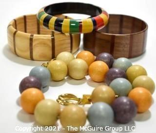 Four (4) Pieces of Vintage Wooden Crafted Jewely - Three (3) Bangle Bracelets and One (1) Bead Necklace.