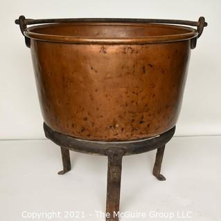 """Antique Hammered Large Copper Cauldron with Hand Forged Iron Base and Handle.  Measures 43""""T (with handle) x 27"""" D (at top).  Base Measure 14""""T.  Includes wood insert."""