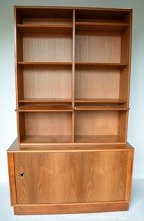 Danish Mid Century Modern (MCM)  Stacking Teak Bookcase & Credenza with Adjustable Shelves, Some Slide Out.   Stamped Made in Denmark by Poul Hundevad. Some damage to base.