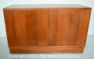 """Danish Mid Century Modern (MCM) Teak Credenza or Cabinet. Stamped Made in Denmark by Poul Hundevad. Measures 42""""W x 17""""D x 27""""T."""