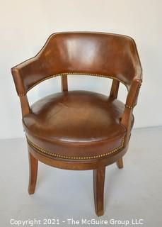 """Vintage Leather Barrel Style Office Chair with Brass Tack Accents on Swivel Base.  Measures 37""""T x 24"""" W."""