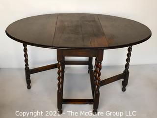 "Antique English Oak Barley Twist Gateleg Table.  Measures 53"" D when open."