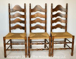 Three (3) Ladder-Back Dining Chairs with Wicker Seats and turned spindle legs