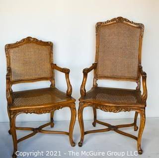 Two (2) French Provincial Style Cane Seat Arm Chairs with Carved Back and Arms.