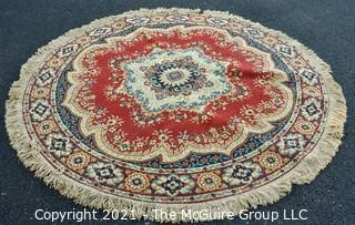 """Machine Made Center Hall Round Rug with Red Ground.  Measures 70""""D."""