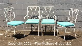 Four (4) Cast Iron White Painted Scroll Work Patio Dining Table Chairs with Blue Padded Chairs.
