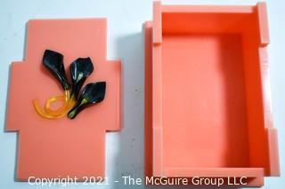 "Mid Century Art Deco Salmon Pink Bakelite Trinket Box with Applied Decoration. Measures 7""L."