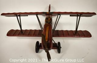 """Vintage Red Painted Folk Art Hanging Wooden Biplane with Pilot.  Measures 26""""L x  14""""T  x 27""""W. (TMG Business card placed for size perspective)"""