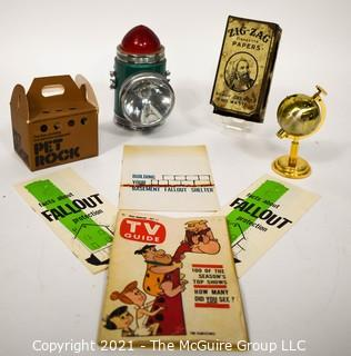 Group of Eclectic Items Including Lantern, Pet Rock, Match Case, Globe Shaped Table Lighter, Fall Out Shelter Brochures and TV Guide.