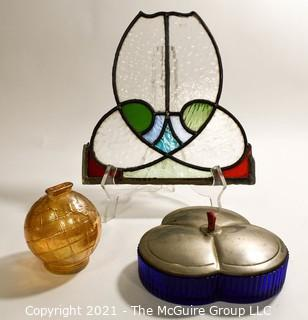Group of Glass Items Including Stained Glass, Blue Glass Divided Candy Dish with Chrome Cover and Pink Iridescent Globe Piggy Bank.