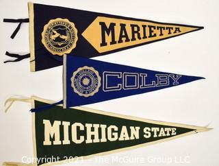 "Three (3) Vintage Felt College Pennants - Marietta, Colby & Michigan State University.  Measures 29""L."