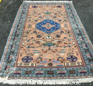 """Vintage Hand Knotted Rug with Center Medallion and Border Pattern with Animals on Blue Background.  Measures 107 x 64"""", with some damage as shown."""
