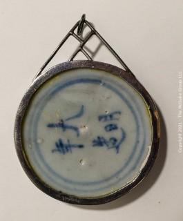 "Asian Potshard (Porcelain Shard) with Silver Surround Pendant Necklace, Blue & White Glaze.  Measures 2 1/2"" diameter."