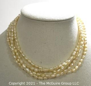 Vintage Four (4) Strand Fresh Water Pearl Necklace with Rhinestone Clasp.