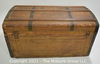 """Primitive Antique Wood Camel Back Trunk with Metal Strapping and Red Interior.  Hand Painted Paper Decoration on Sides.  Measures 23""""L x 13""""T x 13""""W."""