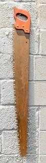 "Vintage One Man ""Warranted Superior"" Crosscut Logging Saw. Measures 49"" long."