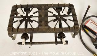 """Vintage Griswold Cast Iron #202 Two Burner Gas Stove with Additional Connecting Hoses.  Measures 17""""L."""