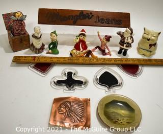 Eclectic Group Including Carved Wood Wrangler Jeans Advertising Counter Top Sign, Porcelain Christmas Elf Figurines, Copper Bas-relief of Native American, Set of Four (4) Bridge Glass Ashtrays & 1940's Puss'n Boots Creamer.