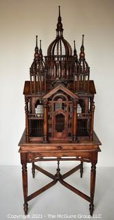 """Antique Victorian Monumental Mahogany Continental Carved Sacre Coeur """"Cathedral"""" Bird Cage with Table Base. Modeled with removable central dome, towers at each corner, portico  and hinged doors on each side, refuse drawer, on conforming carved stand.  Measures 70"""" tall and 26"""" square."""