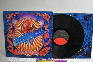 Lot of 4 LP Vinyl Records Hard Rock Titles by Dokken, Cinderella, Judas Priest, and Grim Reaper