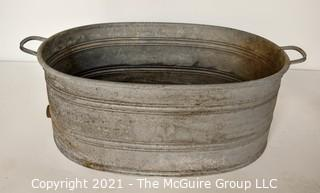 Large Primitive Rustic Oval Galvanized Tub or Basin with Drain at Base and Anchor Makers Mark.
