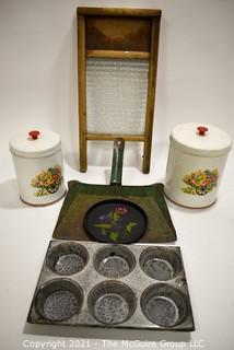 Group of Vintage Primitive Cookware.  Includes Metal Painted Canisters, Glass Washboard & Metal Enamel Graniteware Muffin Tin.