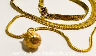 Group of Gold Filled Jewelry.  Includes Flat Herringbone Chain Necklace, Long Chain with Basket Pendant and Matching Pierced Earrings.